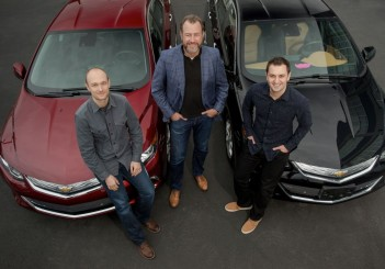 General Motors President Dan Ammann (center) with Lyft Inc. co-f
