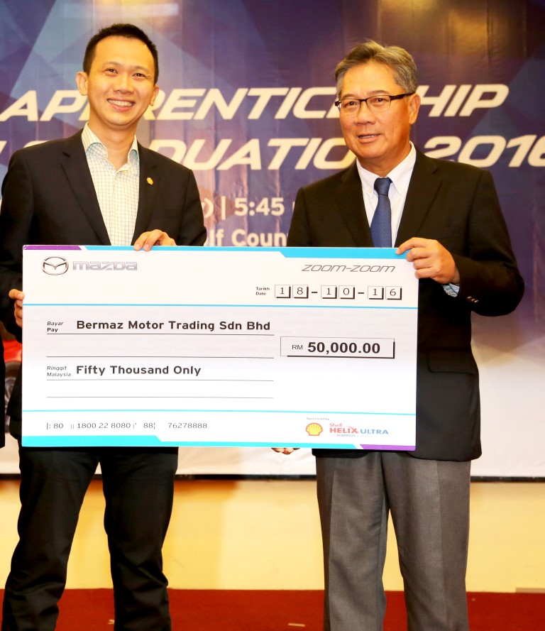 Shell Lubricants Malaysia marketing manager Alex Lim (left) and Bermaz Motor chief executive officer Datuk Seri Ben Yeoh, at a ceremony to mark Shell Malaysia Trading's support of the Mazda Apprenticeship Programme (MAP) via a contribution of RM50,000 annually for the next five years.