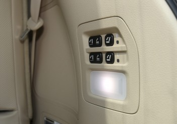 Third row seats are electrically operated with these buttons near the tailgate.