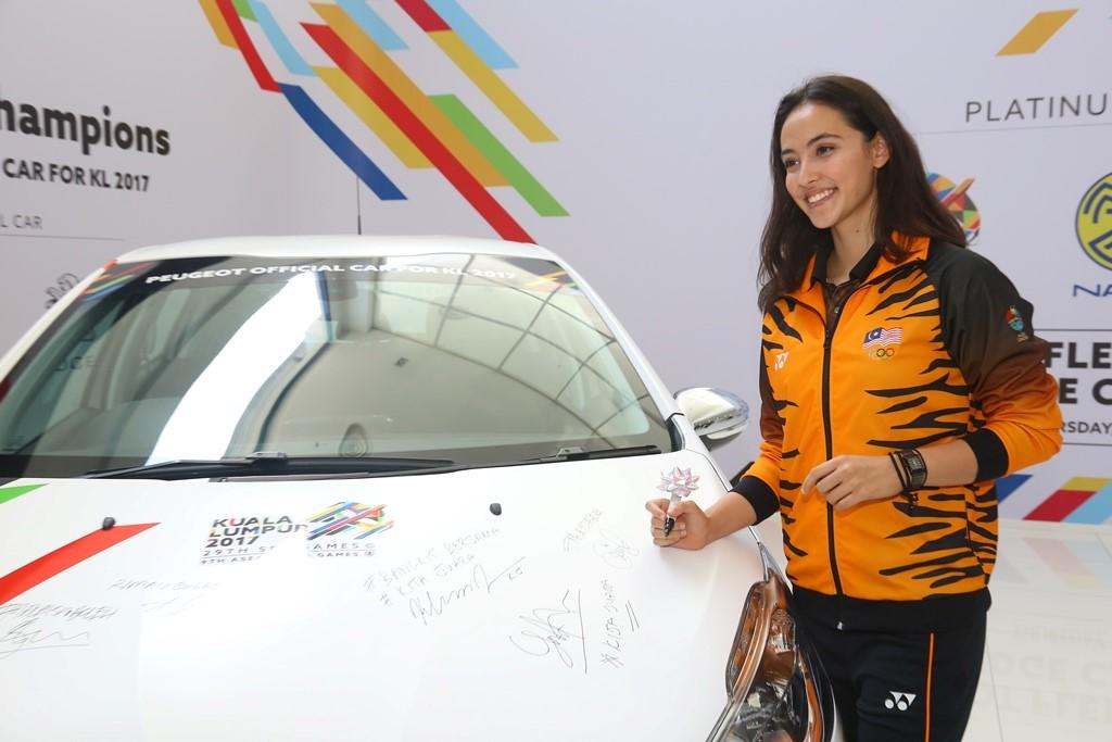 National gymnast Farah Ann Abdul Hadi with the Peugeot 208 pledge car.