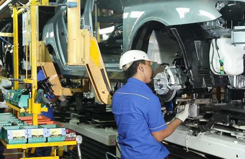 A Proton worker assembling a car at its Tanjung Malim plant.