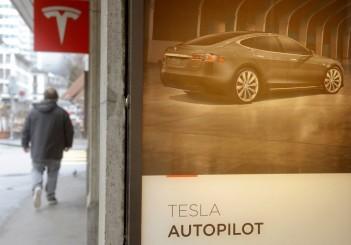 Advertisement promotes Tesla Autopilot at a showroom of U.S. car manufacturer Tesla in Zurich