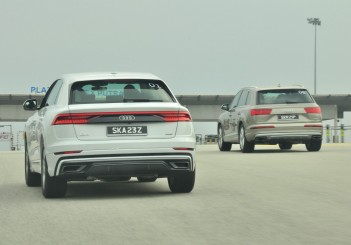 Audi Q8 (L) and Q7 heading for the toll plaza