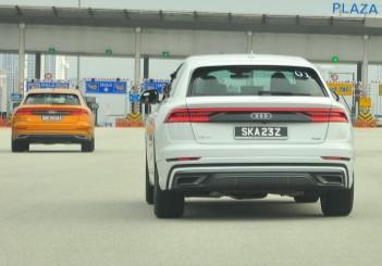 Audi Q8 pair heading to toll plaza