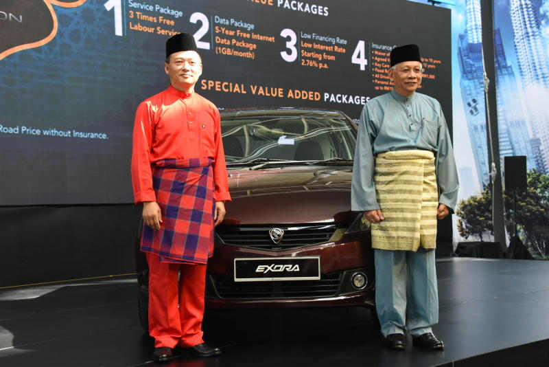 Dr. Li Chunrong, CEO of Proton (left) and Datuk Radzaif Mohamed, DCEO of Proton at the launch of the updated Proton Exora 2019.