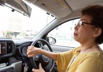 Japanese senior woman driving a car