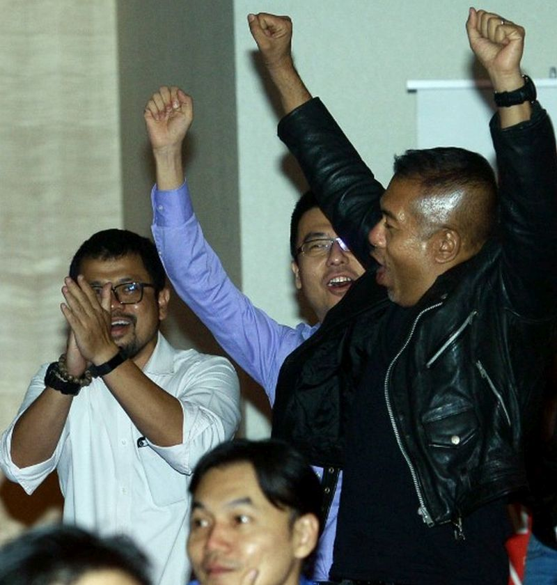 Proton team shout for joy at win